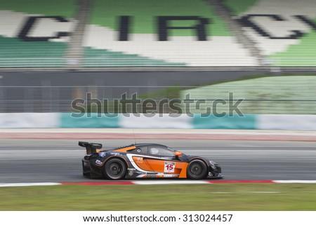 Sepang, Malaysia - September 4, 2015 : British McLaren car no 15 enters turn 1 at Asian Festival of Speed Race, Sepang, Malaysia  - stock photo