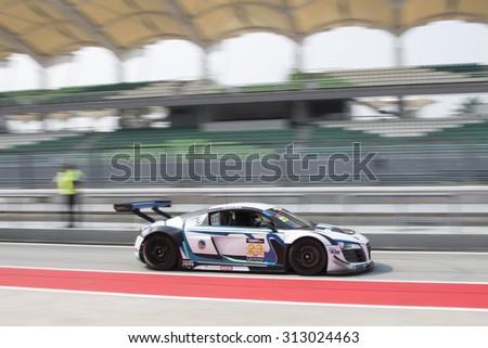 Sepang, Malaysia - September 4, 2015 : German Audi car no 23 exits pit lane at Asian Festival of Speed Race, Sepang, Malaysia  - stock photo