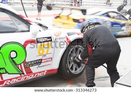 Sepang, Malaysia - September 5, 2015 : German Porsche Car No 87 pits for tires at Asian Festival of Speed Race, Sepang, Malaysia  - stock photo