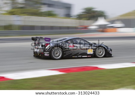 Sepang, Malaysia - September 4, 2015 : Italian Ferrari Car No 95 enters turn 1 at Asian Festival of Speed Race, Sepang, Malaysia  - stock photo