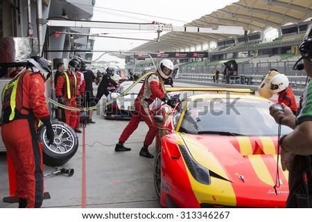 Sepang, Malaysia - September 5, 2015 : Italian Ferrari Car No 37 refuels at Asian Festival of Speed Race, Sepang, Malaysia. Car 37 won the race - stock photo