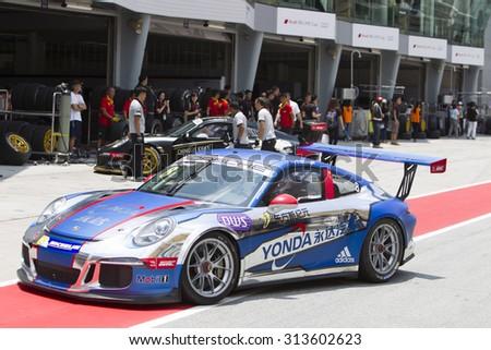 Sepang, Malaysia - September 5, 2015 : Singaporean Ro Skyangel of Team Yonda enters pitlane at Porsche Carrera Cup Asia AFOS, Sepang, Malaysia  - stock photo