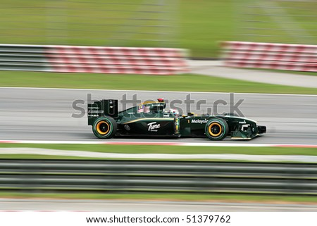 SEPANG, MY - APRIL 4: Jarno Trulli of Lotus Team at the F1 Petronas Malaysian Grand Prix 2010 on April 4, 2010 in Sepang, Malaysia. - stock photo