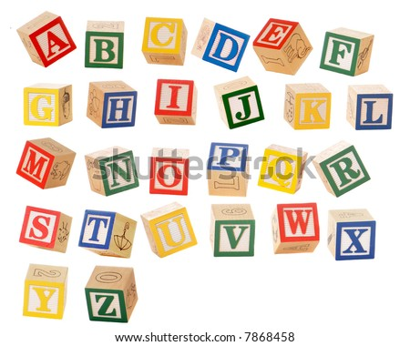 Separated alphabet blocks of all the letters in various orientations, as if they could be falling. - stock photo