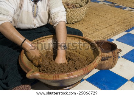 Separating the oil from the mass after grinding the argan nuts - stock photo