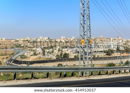 Separation fence and border crossing between Israel and the Palestinian Authority - stock photo