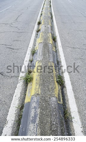 Separation of cement on a road security detail on a road - stock photo