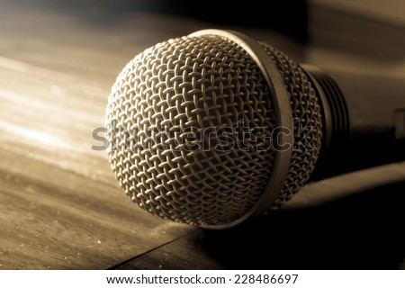 Sepia color filtered of microphone.  - stock photo