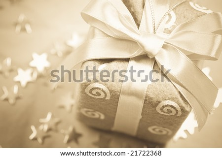 Sepia colors new-year gift background with Christmas decorations - stock photo