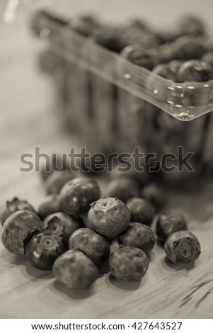 Sepia image of fresh blueberries from a farmer's market are on the counter ready for consumption. - stock photo