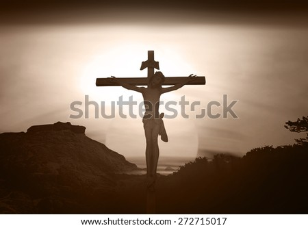 Sepia tone. Silhouette Jesus on the cross over blurred sunset background. - stock photo