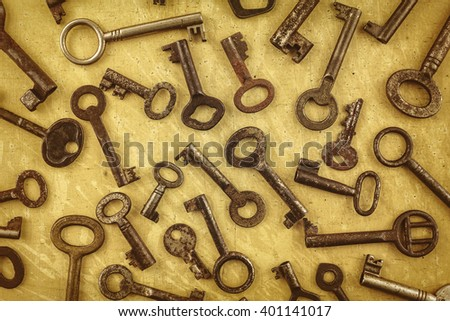 Sepia toned image of different antique rusted keys - stock photo
