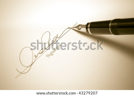 Sepia Toned image of Signature with Gold Fountain Pen - stock photo