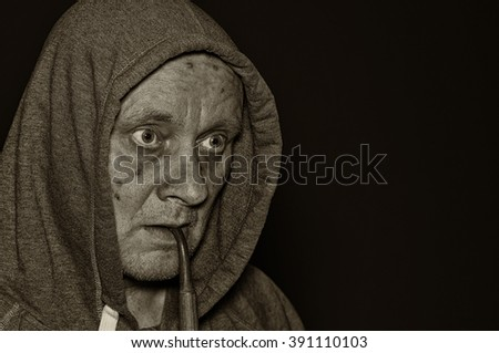 Sepia toned portrait of mature man meditating in darkness - stock photo