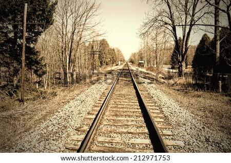 Sepia-toned railroad tracks - stock photo