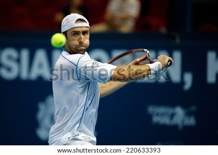 SEPTEMBER 26, 2014 - KUALA LUMPUR, MALAYSIA: Benjamin Becker of Germany  prepares to hit a backhand return in his match at the Malaysian Open Tennis 2014. This event is an ATP sanctioned tournament. - stock photo