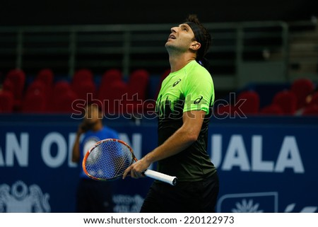 SEPTEMBER 23, 2014 - KUALA LUMPUR, MALAYSIA: Marinko Matosevic of Australia watches the call review on the screen in his match at the Malaysian Open Tennis 2014. This is an ATP sanctioned tournament. - stock photo