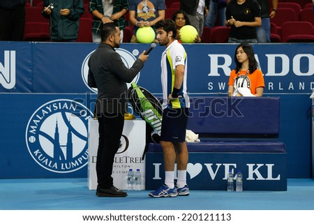 SEPTEMBER 23, 2014 - KUALA LUMPUR, MALAYSIA: Pablo Andujar answers questions after winning his first round match at the Malaysian Open Tennis 2014 event. This is an ATP sanctioned tournament. - stock photo
