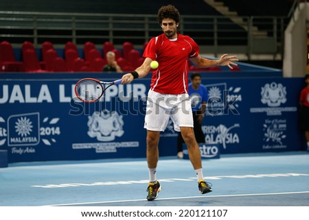 SEPTEMBER 23, 2014 - KUALA LUMPUR, MALAYSIA: Philipp Oswald from Austria makes a forehand return in his first round match at the Malaysian Open Tennis 2014 event. This is an ATP sanctioned tournament. - stock photo
