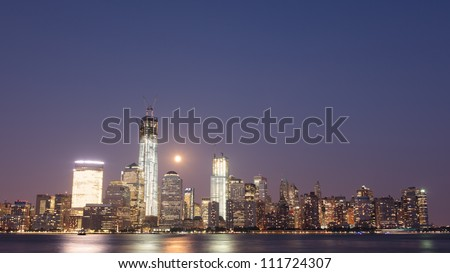 September 2012. Manhattan, downtown Liberty tower (World Trade center) construction. Shot over Hudson river panorama from Jersey city - stock photo