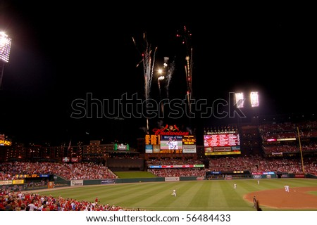 SEPTEMBER 27 - ST. LOUIS: Fireworks fly at the new Busch Stadium after the Cardinals defeated the Cincinnati Reds on September 27, 2008 in St. Louis, MO. - stock photo