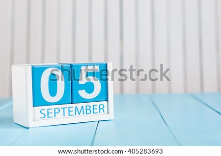 September 5th. Image of september 5 wooden color calendar on white background. Autumn day. Empty space for text - stock photo