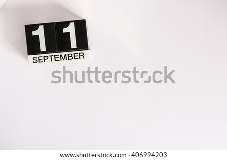 September 11th. Image of september 11 wooden office calendar on white background. Autumn day. Empty space for text - stock photo