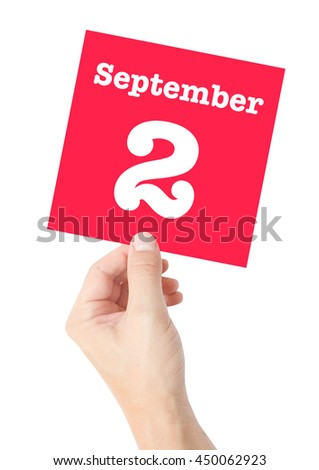 September 2 written on a card held by a hand - stock photo