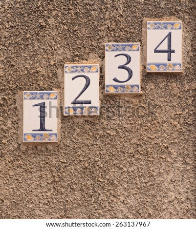 sequence numbers in the wall - stock photo
