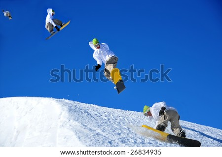 sequence of a snowboarder coming in to land during a high jump. This is a composite image shot in the chronological order of left to right - stock photo
