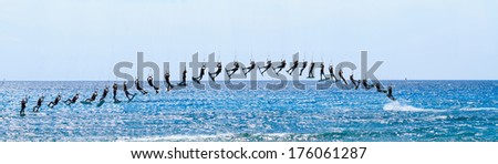 Sequence shot of a kite surfer - stock photo