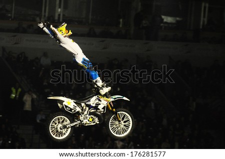 SERBIA, BELGRADE - APRIL 6, 2013:: Motorbike rider performing the trick at Masters of dirt show at Kombank arena, most thrilling and spectacular freestyle motocross show - stock photo