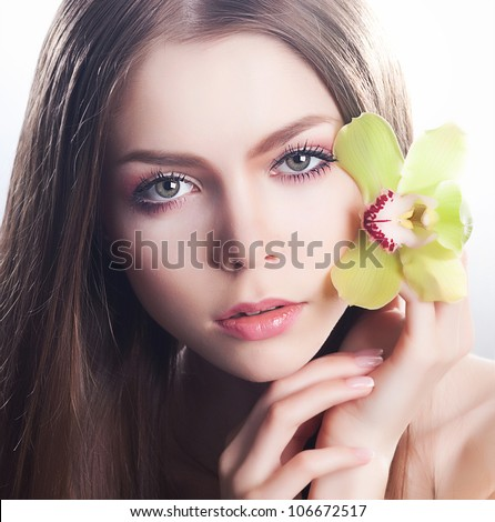 Serene. Fresh clear healthy skin on of beautiful woman face close up portrait - stock photo