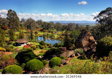 Serene Garden with greens and running water - stock photo