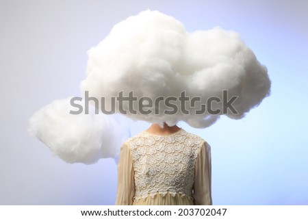 Serene Girl with Her Head in the Clouds - stock photo