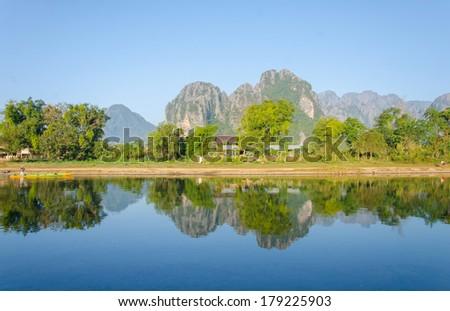 Serene landscape by the Nam Song River at Vang Vieng, Laos. - stock photo