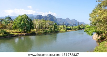 Serene landscape by the Song river at Vang Vieng, Laos - stock photo