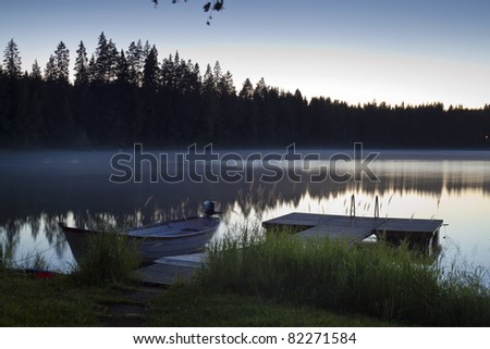 Serene scene photographed at twilight over the lake - stock photo