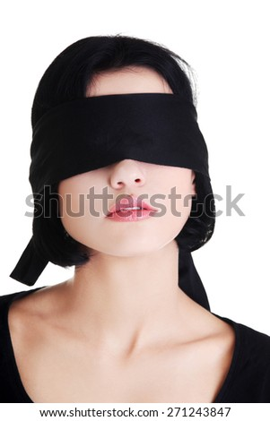 Serene woman with black band on eyes. - stock photo