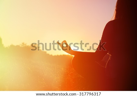 serenity and yoga practice in autumn park at sunset - stock photo