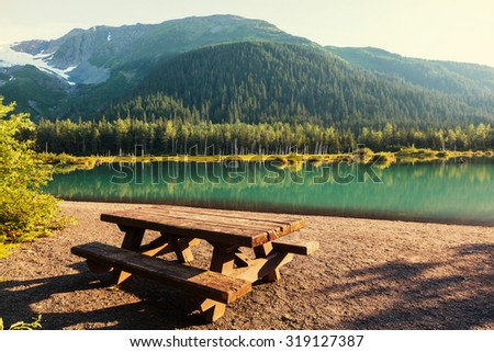 Serenity lake in Alaskan tundra - stock photo