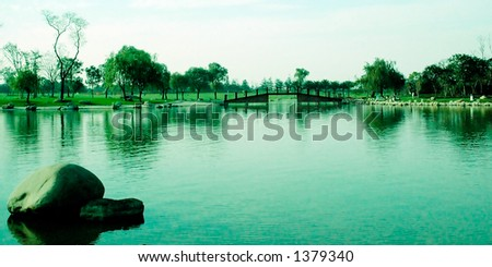 Serenity lake with oriental bridge and boulders More with keyword Series12. - stock photo