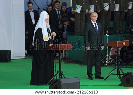 SERGIYEV POSAD, RUSSIA-JUL 18, 2014: President of Russia Vladimir Putin and Patriarch of Moscow and all Rus' Kirill at the celebration of the 700 anniversary of the birthday of St. Sergius of Radonezh - stock photo