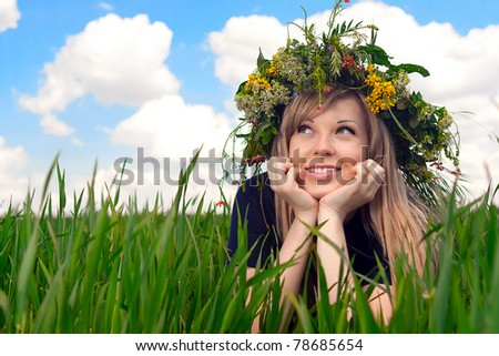 series of closeup portrait of a beautiful girl in a field with a wreath - stock photo