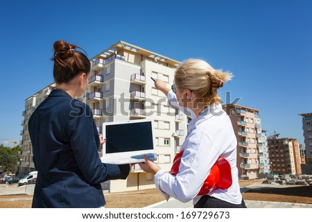 Series of images and video featuring a home, real estate agent, and home owners. Agent showing information for the home sale. - stock photo