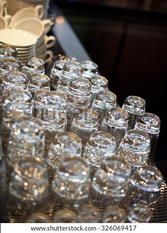 Series of inverted empty wine glasses arranged in several rows. the focus in the center of the frame - stock photo
