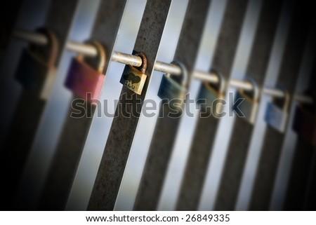 series of padlocks left by teenagers in love as a symbol of eternal love - stock photo