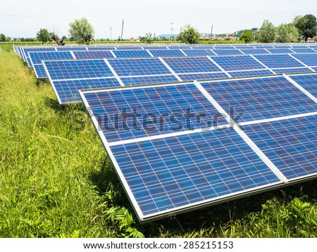 series of photovoltaic panels in a photovoltaic park - stock photo