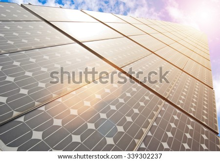 series of solar energy panels under blue sky - stock photo