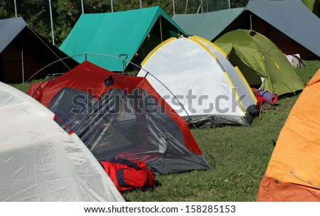 series of tents where they sleep the kids and people sheltered from weather - stock photo